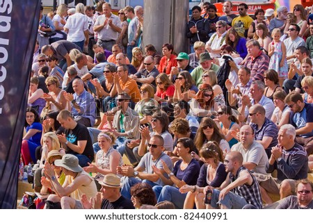 BRISTOL, ENGLAND - JULY 30: An audience shows its appreciation at the Harbour Festival in Bristol, England on July 30, 2011. Founded in 1972, the three day event played host to 280,000 spectators - stock photo