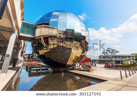 BRISTOL, ENGLAND - JULY 08, 2015: At-Bristol on the Millenium Square, with unidentified people. Its a science centre and charity with stated aim to make science accessible to all - stock photo
