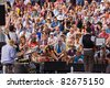 BRISTOL, ENGLAND - JULY 31: Audience and musicians on the Cascade Steps at the Harbour Festival in Bristol, England on July 31, 2011. The three day event played host to a record 280,000 spectators - stock photo