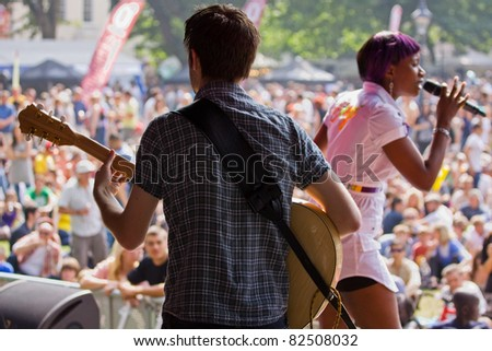 BRISTOL, ENGLAND - JULY 30: Guitarist backing soul singer Celestine at the Harbour Festival in Bristol, England on July 30, 2011. The free three day event played host to a record 280,000 spectators - stock photo