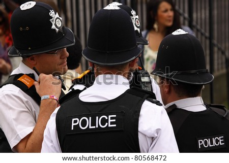 BRISTOL, ENGLAND - JULY 2: Part of the police presence at the Afrikan Caribbean carnival in St Pauls Bristol, England on July 2, 2011. 80,000 people attended the 43rd running of the street event - stock photo