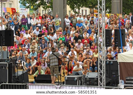 BRISTOL, ENGLAND - JULY 31: Performer out front on the Cascade Steps stage at the Harbour Festival on July 31, 2010 in Bristol, England. The free festival played host to more than 250,000 spectators - stock photo