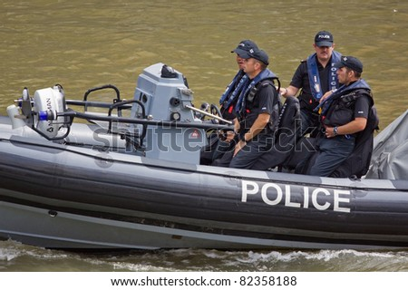 BRISTOL, ENGLAND - JULY 31: Police patrol the harbour during the annual festival in Bristol, England on July 31, 2011. Founded in 1972, the three day event attracted a record 280,000 spectators - stock photo
