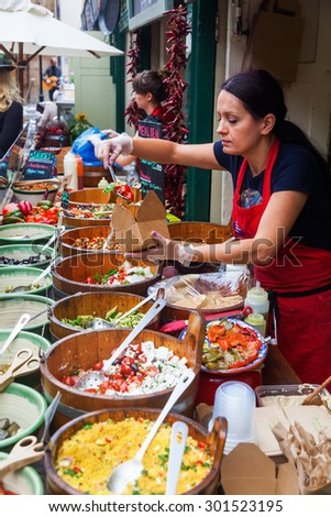BRISTOL, ENGLAND - JULY 08, 2015: St Nicolas Market with unidentified people. Its located on Corn Street, in The Exchange and is also home to Bristol Farmers Market, Nails Market, and Slow Food Market - stock photo
