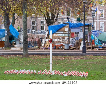 BRISTOL, ENGLAND - NOVEMBER 18: Remembrance Day poppies in front of the Occupy Bristol anti-capitalism protest camp outside the Cathedral and Council House in Bristol, England on November 18, 2011