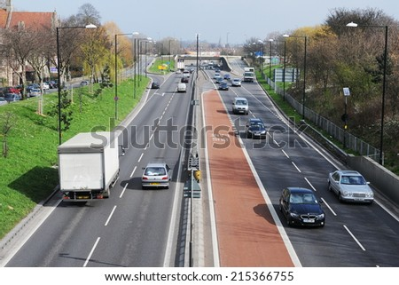 BRISTOL - MAR 17: Traffic moves along a busy city centre dual carriageway on Mar 17, 2011 in Bristol, UK. Government statistics indicate traffic congestion costs Bristol £350 million per year. - stock photo