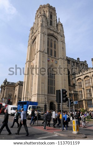 BRISTOL - MARCH 24: Pedestrians cross a street outside the University of Bristol on March 24, 2011 in Bristol, UK. Founded in 1909 the University of Bristol is currently home to 19,000 students. - stock photo