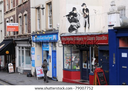BRISTOL - MARCH 17: Stencil graffiti piece by Banksy on a building on Mauldin Street March 17, 2011 in Bristol. Banksy is an anonymous England based graffiti artist, political activist, film director and painter. - stock photo