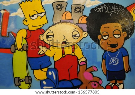 BRISTOL - NOV 7: A graffiti piece of well-known cartoon characters by an unidentified artist on a wall in the city centre on Nov 7, 2010 in Bristol, UK. Bristol is renowned for its street art. - stock photo