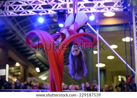 BRISTOL - NOV 7: An unidentified trapeze artist peforms at Cabot Circus as the shopping mall officially opens for the Christmas holiday season on Nov 7, 2014 in Bristol, UK.  - stock photo