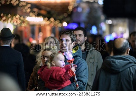 BRISTOL - NOV 7: Shoppers visit the German Christmas Market at Broadmead on Nov 7, 2014 in Bristol, UK. Broadmead is the city's principal shopping district and home to the annual Christmas market. - stock photo