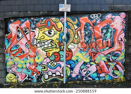 BRISTOL - NOV 8: View of a graffiti piece by an unidentified artist on a city centre wall on Nov 8, 2010 in Bristol, UK. Bristol is renowned for its vibrant graffiti and street art scene. - stock photo