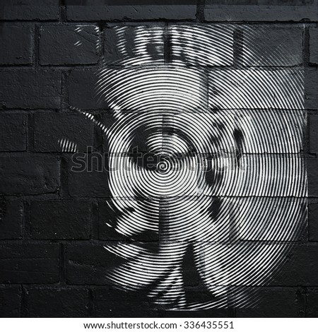 BRISTOL - OCT 31: View of a Buddha inspired stencil graffiti piece on a city centre wall on Oct 31, 2015 in Bristol, UK. The west country city is famous for its street art and graffiti. - stock photo