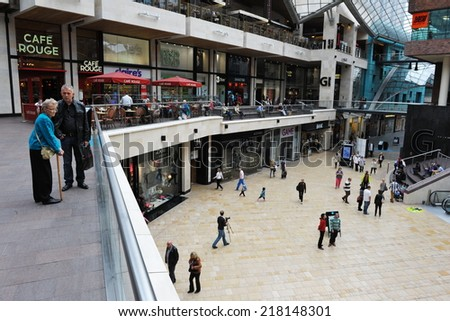 BRISTOL - SEP 21: Shoppers gather in the newly opened Cabot Circus shopping centre on Sep 21, 2012 in Bristol, UK. Cabot Circus boasts 1,000,000 sq ft of retail outlets and leisure facilities. - stock photo