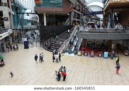 BRISTOL - SEP 21: Shoppers walk through the newly opened Cabot Circus shopping mall on Sep 21, 2012 in Bristol, UK. Cabot Circus houses over 1,000,000 sq ft of retail outlets and leisure facilities. - stock photo