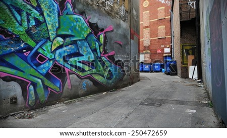 BRISTOL - SEP 26: View of graffiti on walls of an inner city alleyway on Sep 26, 2010 in Bristol, UK. Bristol is renowned for its vibrant graffiti and street art scene. - stock photo