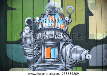 BRISTOL - SEPT 21: View of a graffiti piece by an unidentified artist on a door in the Stokes Croft area of the city on Sep 21, 2012 in Bristol, UK. Bristol is famed for its vibrant street art scene. - stock photo