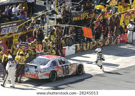 BRISTOL, TENNESSEE - MARCH 22: Kyle Busch makes a pit stop with the Snickers Toyota during the Food City 500 Nascar race at the Bristol Motor Speedway in Bristol, Tenn on March 22, 2009. - stock photo