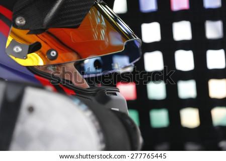 Bristol, TN - Apr 17, 2015:  Denny Hamlin (11) straps into his car for the Food City 500 at Bristol Motor Speedway in Bristol, TN. - stock photo