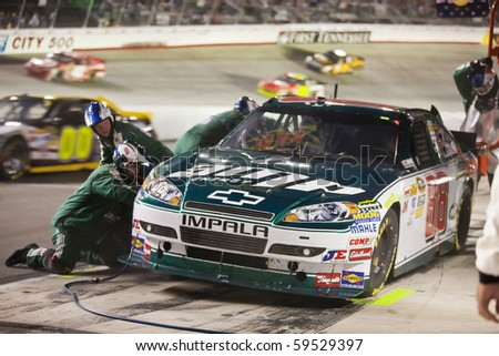 BRISTOL, TN - AUG 21:  Dale Earnhardt, Jr. brings his the Amp Energy Chevrolet in for service during the Irwin Tools Night Race race at the Bristol Motor Speedway in Bristol, TN on Aug 21, 2010. - stock photo