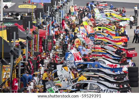 BRISTOL, TN - AUG 20:  The NASCAR Sprint Cup teams make adjustments to their cars before practice for the Irwin Tools Night Race race at the Bristol Motor Speedway in Bristol, TN on Aug 20, 2010. - stock photo