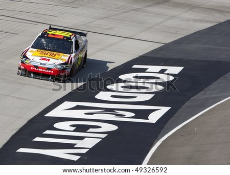 BRISTOL, TN - MAR 19: Greg Biffle brings his Census 2010 Ford through the turns during a practice session for the Food City 500 race at the Bristol Motor Speedway on Mar 19, 2010 in Bristol, TN. - stock photo