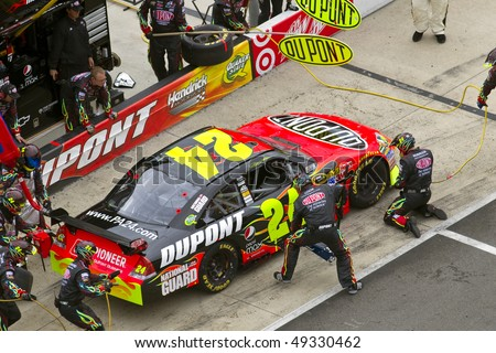 BRISTOL, TN - MAR 21: Jeff Gordon brings his DuPont Chevrolet in for service during the running of the Food City 500 race at the Bristol Motor Speedway on Mar 21, 2010 in Bristol, TN. - stock photo