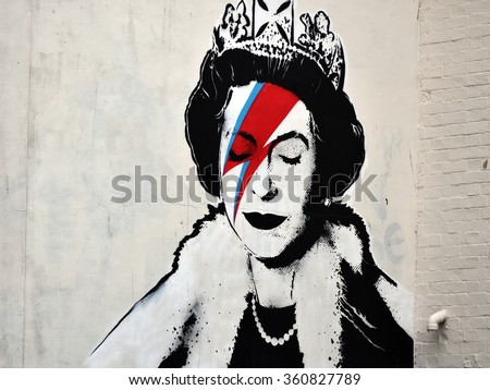 BRISTOL, UK - AUG 21, 2015: View of a Banksy piece depicting the Queen as David Bowie in his Ziggy Stardust persona seen on a city centre street. Banksy is a world renowned street artist from Bristol.
