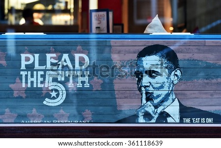 BRISTOL, UK - OCT 31, 2015: View of Barack Obama themed artwork in the window of a city centre restaurant. The west country city is famous for its graffiti and street art scene.  - stock photo