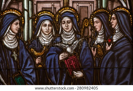 BRISTOW, VIRGINIA - APRIL 26, 2015: Stained glass window depicting five Benedictine female saints, Saints Hildegard, Walburga, Scholastica, Mechtild, and Gertrude, located at St. Benedict Monastery - stock photo