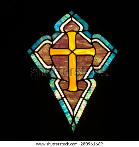 BRISTOW, VIRGINIA - APRIL 26, 2015: Stained glass window depicting  the cross, in chapel of St. Benedict Monastery - stock photo