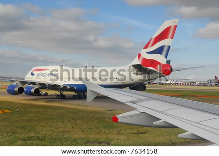 british airways airplane ready for take-off at heathrow airport, london UK - stock photo