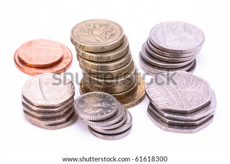 British currency coins on white background
