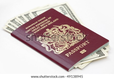 British (European Union) passport with US currency isolated on white - stock photo