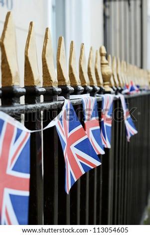 British flag bunting on iron railings - stock photo