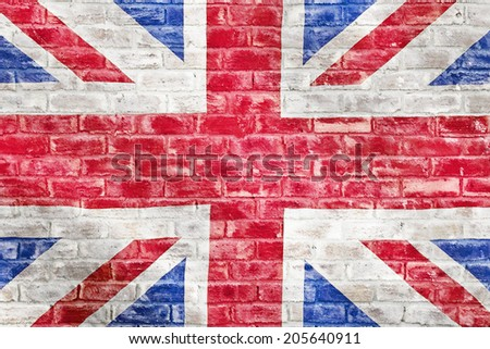 British flag on a brick wall to be used as a wallpaper or background - stock photo