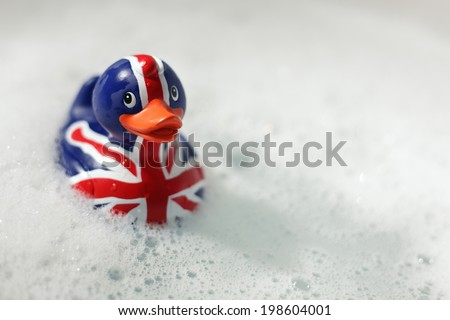 British flag rubber duck in the bath... Britannia rules the waves concept - stock photo