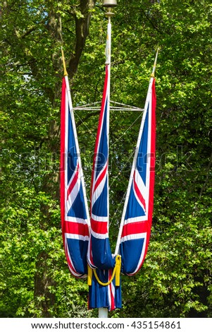 British flags with green trees as background - stock photo