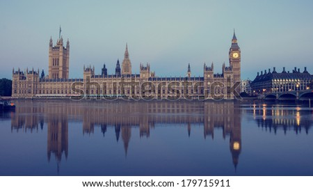 British houses of parliament with a vintage filter applied - stock photo