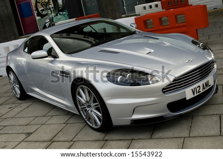 BRITISH INTERNATIONAL MOTORSHOW JULY 30: parked silver aston martin dbs at british motorshow