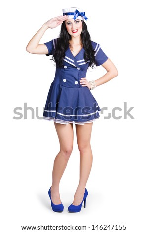 British navy blue pin up girl standing to attention in sailor uniform while saluting in cute retro military style - stock photo