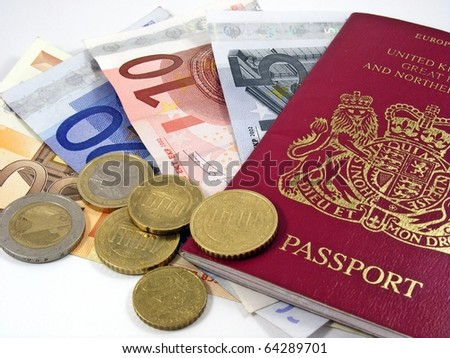 British passport with euro currency banknotes & coins