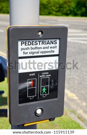 British pedestrian crossing button with  wait sign - stock photo