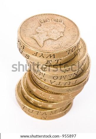 british pound coins over white - stock photo