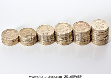 British pound sterling coins stack in columns symbolizing wealth growth - stock photo