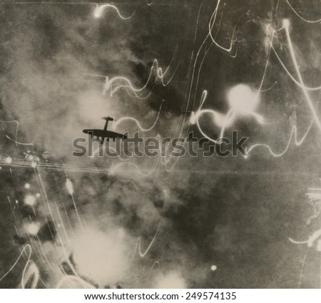 British RAF bomber and trails of light from incendiary bombs. Photo taken of the bombing of the shipbuilding yards in Hamburg during World War 2. Jan. 12, 1943. - stock photo