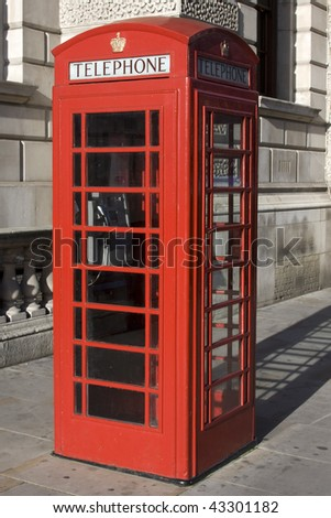 British Red phone box with the word telephone across the top