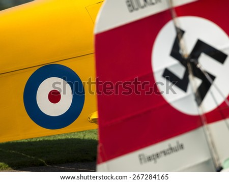 British roundel and german swastika insignia on aircraft at Breighton airfield,yorkshire,UK.taken 14/07/2013
