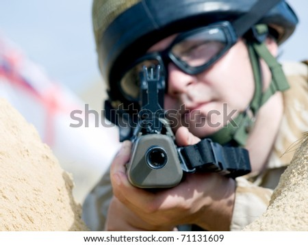 British Royal Commando aiming at you - stock photo