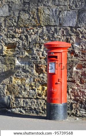 British Royal Mail red post box - stock photo